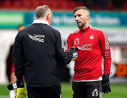 Aberdeen goalkeeper Gary Woods (right) and goalkeeping coach Gordon Marshall warming up prior to kick-off during the cinch Premiership match at Pittodrie Stadium, Aberdeen. Picture date: Sunday October 3, 2021.