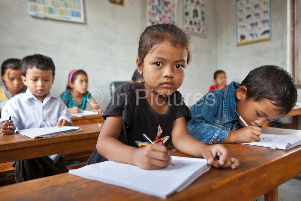 Young children in a nursery class room learning to write at the GoodWeave centre in Attarkhen, Kathmandu, Nepal.  They are children of carpet factory workers, and have been supported into education by GoodWeave, a charity that works towards getting children out of factories and into education.  Previously these children would have been left unattended in the factory while their parents worked as their low salary could not cover childcare costs. GoodWeave were recipients of the Stars Foundation's Impact Award.