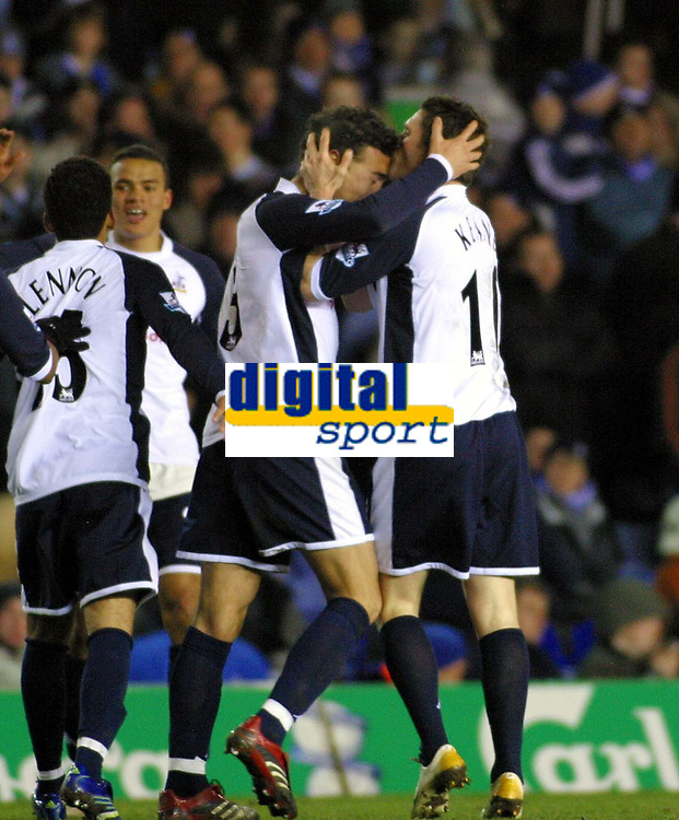 Photo: Dave Linney.<br />Birmingham City v Tottenham Hotspur. The Barclays Premiership. 18/03/2006Spurs goalscorer .Robbie Keane(R) plants  a kiss on the head of  Stephen Kelly