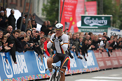Tony Martin of Germany celebrates as he crosses the finish line to win the Elite Men's Time Trial on day three of the UCI Road World Championships on September 21, 2011 in Copenhagen, Denmark. (Photo by Marjan Kelner / Sportida Photo Agency)