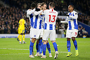 Brighton and Hove Albion midfielder Pascal Gross (13) congratulates Brighton and Hove Albion striker Glenn Murray (17) after his goal with Brighton and Hove Albion midfielder Jose Izquierdo (19) during the Premier League match between Brighton and Hove Albion and Crystal Palace at the American Express Community Stadium, Brighton and Hove, England on 4 December 2018.