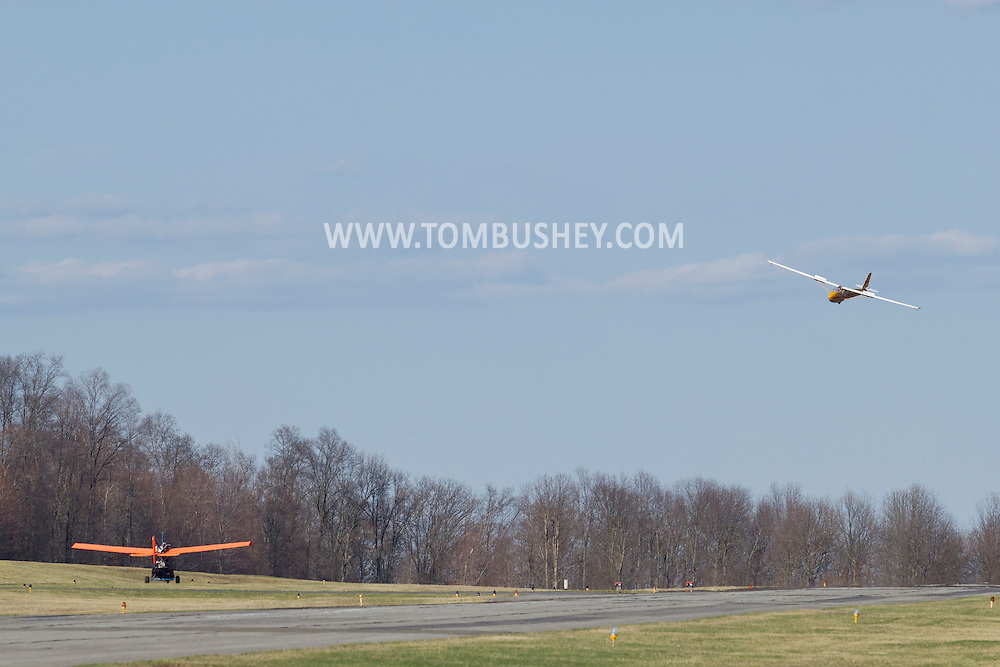 Middletown, New York - The pilot of an experimental aircraft taxis on a runway while a glider comes in for a landing at  Randall Airport on  April 12, 2014.