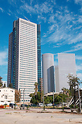 Israel, Tel Aviv, Modern Highrise buildings. The Rubinstein Building in the foreground and the Azrieli centre in the background view from south west