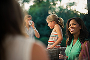 SEPTEMBER 13, 2016: Adults and children spend time together outside in the backyard.