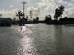 September 13, 2017 - Everglades City, Florida, U.S.- The streets of Everglades City became waterways after Hurricane Irma rolled through. This is Collier Avenue, the main drag. (Credit Image: © Kate Irby/TNS via ZUMA Wire)