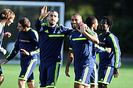 Swansea city players Chico Flores (l) with Ashley Williams ® wave to the camera's.  Swansea city FC training at their training base in Landore  in Swansea, South Wales on Wed 23rd Oct 2013. The team are training ahead of the UEFA Europa league match v FC Kuban Krasnodar . pic by Andrew Orchard, Andrew Orchard sports photography,