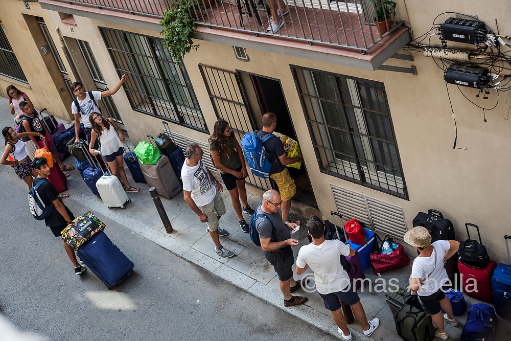 Tourists entering a tourist apartment in the Vila de Gràcia neighbourhood. While the rental market of holiday apartments through platforms like Airbnb is booming, one out of every three residents of the Barcelona area do not have access to decent housing.