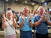 "15 JUNE 2019 - BOONE, IOWA: People applaud for US Senator Joni Ernst at ""Joni's Roast and Ride,"" an annual motorcycle ride / barbecue fund raiser hosted by Ernst. Ernst, Iowa's junior US Senator, kicked off her re-election campaign during the ""Roast and Ride"", an annual fund raiser and campaign event has she held since originally being elected to the US Senate in 2014.   PHOTO BY JACK KURTZ"