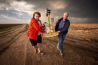 Storm Chasers Brandon Molyneaux and Tim Marshall retrieve a tornado pod after it was struck by a tornado near Dodge City, Kansas, May 24, 2016.