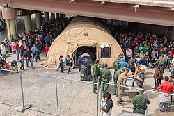 Mar 22, 2019 - El Paso, Texas, U.S. - In this photo provided by U.S. Customs and Border Protection, migrants are seen inside an enclosure in El Paso after crossing the border between Mexico and the United States illegally and turning themselves in to request asylum.  (Credit Image: © Mani Albrecht/U.S. Customs and Border Protection via ZUMA Wire)