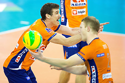 Players of ACH Volley celebrate during volleyball match between ACH Volley Ljubljana and Asseco Resovia Rzeszow in 2nd Round of CEV Champions League, on November 19, 2014 in Hala Tivoli, Ljubljana, Slovenia. Photo by Matic Klansek Velej / Sportida