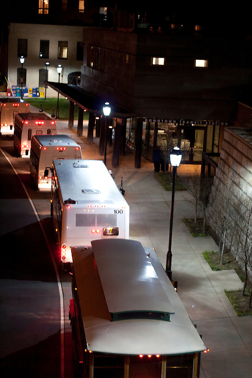 Buses line up in the evening outside the Downtown Transit Center, Charlottesville, Virginia.