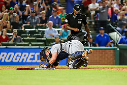 May 7, 2018 - Arlington, TX, U.S. - ARLINGTON, TX - MAY 07: Detroit Tigers catcher James McCann (34) stumbles trying to field a ball during the game between the Texas Rangers and the Detroit Tigers on May 07, 2018 at Globe Life Park in Arlington, Texas. Texas defeats Detroit 7-6. (Photo by Matthew Pearce/Icon Sportswire) (Credit Image: © Matthew Pearce/Icon SMI via ZUMA Press)