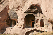 Exterior view of the early Christian rock monastery in volcanic rock. 8th-9th cent AD. Cathedral of Selime in Cappadocia, Ilhara Vallet, Turkey