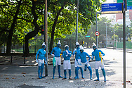Friends from São Paulo, Brazil, visiting Rio de Janeiro during Carnival, walk the streets of Ipanema dressed and painted like Smurfs. (March 5, 2019)