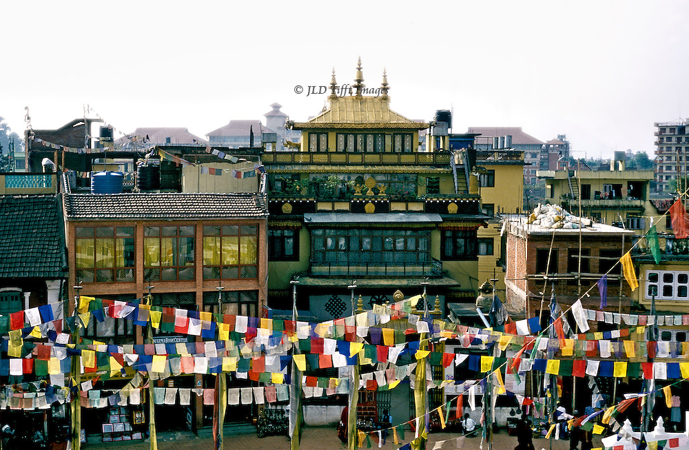 Kathmandu, Bodhnath Stupa, surrounded with prayer flags for Dasain festival.  View of Kathmandu city from the roof of the stupa.