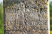 Commemorative cross on stone base saying Mire l'Etang 10 October 1894 (year is uncertain) Chateau Mire l'Etang. La Clape. Languedoc. France. Europe.