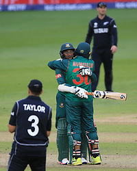 Bangladesh's Shakib Al Hasan (left) is congratulated by Mahmudullah after reaching his century during the ICC Champions Trophy, Group A match at Sophia Gardens, Cardiff.