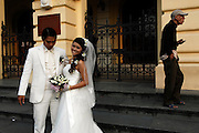 Newlyweds have their photographs taken on the steps of the French built Opera House, French Quarter, Hanoi