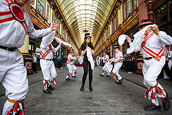 © Licensed to London News Pictures. 23/04/2018. London, UK. The Ewell St Mary's Morris Men dance around a member of the public at a St George's Day celebration in Leadenhall Market. Photo credit: Rob Pinney/LNP