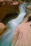 The Freemont River flows through a narrow sandstone gorge near the Fruita Orchard in Capitol Reef National Park, Utah.