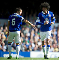 Everton's Phil Jagielka (L) and Marouane Fellaini<br /> <br />  (Photo by Stephen White/CameraSport) <br /> <br /> Football - Barclays Premiership - Saturday 24th August 2013 - Everton v West Bromwich Albion - Saturday 24th August 2013 - Goodison Park - Liverpool<br /> <br /> © CameraSport - 43 Linden Ave. Countesthorpe. Leicester. England. LE8 5PG - Tel: +44 (0) 116 277 4147 - admin@camerasport.com - www.camerasport.com