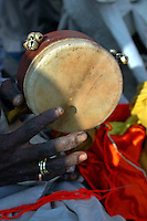"""India, Nasik, 2006. """"Sadhus,"""" or traveling holy men, play religious music by the banks of the Godavari River, a pilgrimage site for many Hindus."""