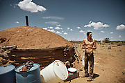 "Che, son of Kat...Meeting with Kat, a Navajo Indian shepherd living in a traditional Hogan (the primary traditional home of the Navajo people, similar in appearance to a Yurt) in the Black Mesa. Black Mesa is an upland area in Navajo County, Arizona, it derives its dark appearance from the numerous seams of coal which run through it. .Kat resisted the relocation imposed by US law that  intended to encourage Native Americans to leave Indian reservations and assimilate into the general population - in order to better exploit natural ressources available on the reservations. The relocations played a decisive role in increasing the population of urban Indians...A 4-weeks road trip across the USA, from New York to San Francisco, on the steps of Jack Kerouac's famous book ""On the Road"".  Focusing on nomadic America: people that live on the move across the US, out of ideology or for work reasons."