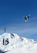 SHOT 12/17/10 2:27:44 PM - Mark McMorris back flips off a kicker in Snowboard Slopestyle qualifying during the Nike 6.0 Open stop of the Winter Dew Tour at Breckenridge Ski Resort in Breckenridge, Co. McMorris would qualify and finish second in the event with a core of 93.75. The event features ski and snowboard slopestyle and superpipe. (Photo by Marc Piscotty / © 2010)