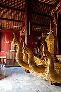 Image of the interior of the Royal Carriage House at Wat Xiengthong, Luang Prabang, Laos.