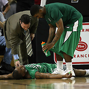 Marshall forward Tirrell Baines (30) lays on the ground during a Conference USA NCAA basketball game between the Marshall Thundering Herd and the Central Florida Knights at the UCF Arena on January 5, 2011 in Orlando, Florida. Central Florida won the game 65-58 and extended their record to 14-0.  (AP Photo/Alex Menendez)