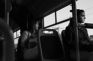 Ermina Kepeš rides the bus to work from her home in Sarajevo, Bosnia, July 17, 2013. When she's running late she takes the bus instead of the Tram to arrive 10 minutes earlier, but doesn't do this often as it costs more money.