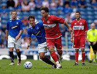 Photo: Jed Wee.<br />Glasgow Rangers v Middlesbrough. Pre Season Friendly. 22/07/2006.<br /><br />Middlesbrough's Fabio Rochemback (R) shrugs off the challenge of Rangers' Jeremy Clement.