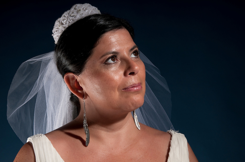Latin woman in his 40 getting ready to be married, very pensive.