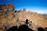The photographer's shadow on the lava fields in The Teide volcano (the highest mountain of Spain, 3.718 m), at sunrise. Teide National Park, Tenerife Island, Canary Islands, Spain.