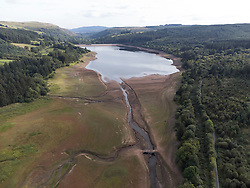 © Licensed to London News Pictures. 21/09/2021. Merthyr Tydfil, UK. Llwyn Onn reservoir in Merthyr Tydfil, Wales, where the levels are dramatically low. Photo credit: Andrew Bartlett/LNP
