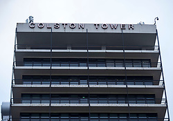 """© Licensed to London News Pictures; 11/06/2020; Bristol, UK. The words """"Colston Tower"""" can be seen on one side of Colston Tower after contractors removed the letters from the other side of the office block in the city centre, following renewed controversy over the name of 17th century slave trader and Bristol philanthropist Edward Colston. At a Black Lives Matter protest the previous Sunday the statue of slave trader Edward Colston which has stood in Bristol city centre for over 100 years was pulled down with ropes and thrown in Bristol Docks by protesters during the BLM rally and march through the city centre in memory of George Floyd, a black man who was killed on May 25, 2020 in Minneapolis in the US by a white police officer kneeling on his neck for nearly 9 minutes. Edward Colston (1636 – 1721) was a wealthy Bristol-born English merchant involved in the slave trade, a Member of Parliament and a philanthropist. He supported and endowed schools, almshouses, hospitals and churches in Bristol, London and elsewhere, and his name is commemorated in several Bristol landmarks, streets, three schools and the Colston bun. The killing of George Floyd has seen widespread protests in the US, the UK and other countries. Photo credit: Simon Chapman/LNP."""
