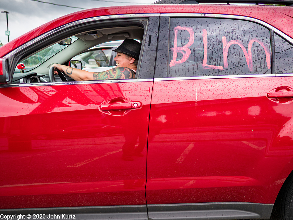 19 JUNE 2020 - DES MOINES, IOWA: A woman participates in a Black Lives Matter caravan at the State Fairgrounds during Juneteenth celebrations in Des Moines. The caravan drove through the Des Moines metro area. The caravan was called Ride With Us, a Driving March. Hundreds of motorists participated in the rush hour event.    PHOTO BY JACK KURTZ