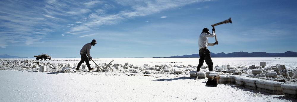 Miners working on Salar de Uyuni salt flats, Potosi, Bolivia. The Salar de Uyuni are the worlds largest salt flats.