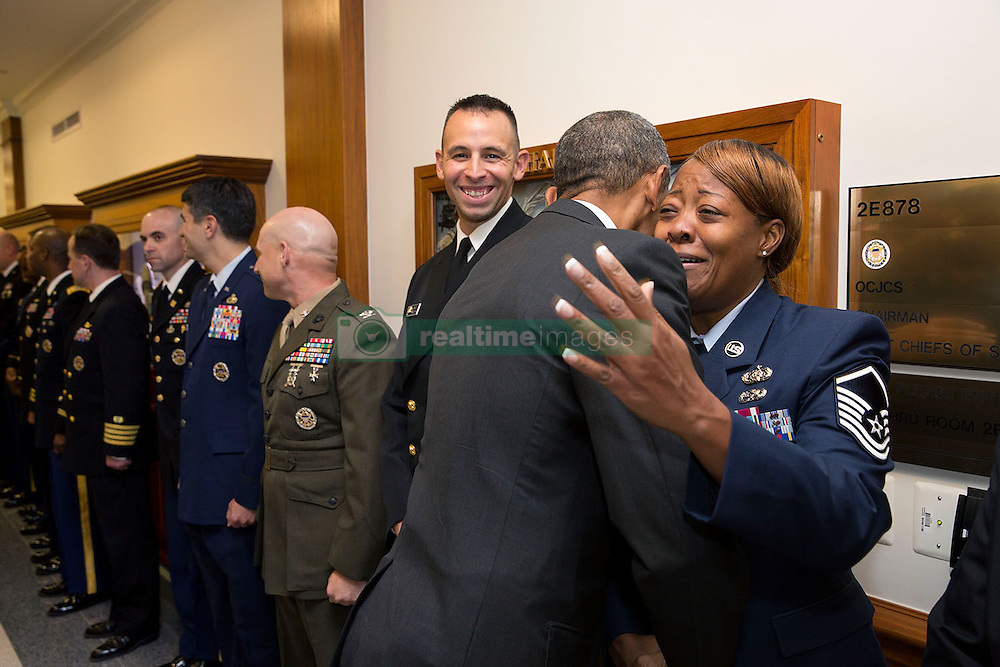 President Barack Obama greets U.S. service members at the Pentagon in Arlington, Va., Oct. 8, 2014. (Official White House Photo by Pete Souza)<br /> <br /> This official White House photograph is being made available only for publication by news organizations and/or for personal use printing by the subject(s) of the photograph. The photograph may not be manipulated in any way and may not be used in commercial or political materials, advertisements, emails, products, promotions that in any way suggests approval or endorsement of the President, the First Family, or the White House.