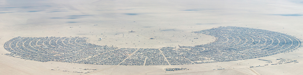 This aerial photograph of Black Rock City was shot on the morning of Friday August 31st, 2018 during Burning Man 2018. The pilot of the aircraft was Purple Haze. This image is about 135 Megapixels.