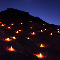 Africa, Namibia, Swakopmund. Lanterns light a canyon in the Landscape of the Moon east of Swakopmund.