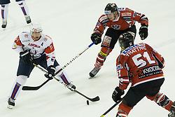 Mitja Robar of Slovenia vs Matthias Trattnig and Michael Raffl of Austria during ice-hockey match between Slovenia and Austria in Slovenia Euro ice hockey challenge, on November 10, 2012 at Hala Tivoli, Ljubljana, Slovenia. (Photo By Grega Valancic / Sportida)