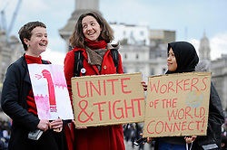© Licensed to London News Pictures. 01/05/2018. LONDON, UK.  Women pose with signs during the annual May Day Rally on International Workers' Day, having marched through central London to a rally in Trafalgar Square.  Photo credit: Stephen Chung/LNP