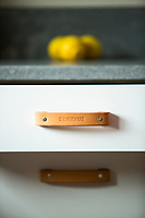 Cabinet handles by leather craftmaker Walnut.