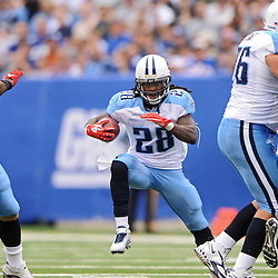 Running back Chris Johnson #28 of the Tennessee Titans rushes the ball during first half NFL football action between the New York Giants and Tennessee Titans at New Meadowlands Stadium in East Rutherford, New Jersey. The game is tied at half time.