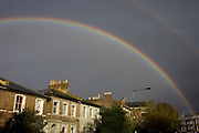 Double rainbows arc over houses in Brixton, South London.
