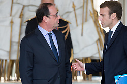 French President Francois Hollande speaks with French Economy and Industry minister Emmanuel Macron after the weekly Council of Ministers at Elysee Palace in Paris, France on November 12, 2014. Photo Thierry Orban/ABACAPRESS.COM