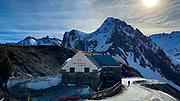 A skier passes the Restaurant Col de Tourmalet, La Mongie ski resort,  Bagnères-de-Bigorre, France.