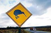 Freight transport truck passes road traffic sign - look out for kiwis, North Island, New Zealand
